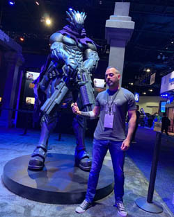 Joe Madureira at E3 with the strife statue